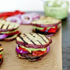 """Sweet potato bun sliders with a portobello mushroom """"burger"""", roasted red peppers, and pesto """"mayo."""" Paleo, vegan and gluten-free, these sliders are the perfect summer meal."""