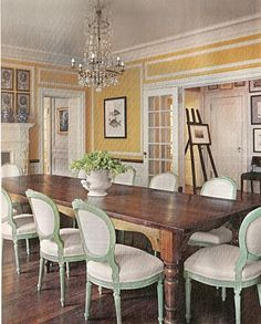 yellow dining room. LOVE the green and white chairs!