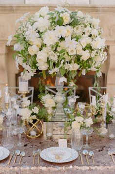 An elegant centerpiece, that will definitely draw attention, overflows with white blooms and lush greenery. Wedding Decorations, White Wedding Flowers, Centerpiece