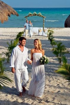 This is pretty much how I plan to do it. Eloping barefoot on a beach!