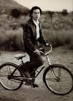 Johny Deep on a bicycle