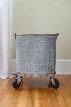 galvanized bucket on wheel