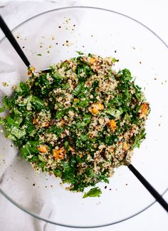 Healthy and delicious quinoa salad with roasted sweet potato kale and pesto vinaigrette - cookieandkate.com
