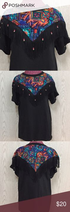 """Vintage Fringe Shirt Because of colors and tag it looks to be 90s. Looks never worn. Shirt is like a thick cotton Tshirt with metals studs around the sleeves. Measurements: P2P 22"""" Length 27"""" Vintage Tops Tees - Short Sleeve"""