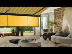 The Markilux Shade Plus Drop-Down Valance provides customized shade control and additional privacy in our retractable casette awnings Valance, Curtains, How To Shade, Palm Beach, Patio Awnings, Yard, Shades, Umbrellas, Tents