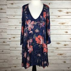 "[Free People] Eyes On You Floral Printed Dress 6 Gorgeous floral bohemian dress. V neck. Pullover style. Back button closures. Hidden side zip closure. Fully lined. 3/4 bell sleeves.  🔹Color: Navy Combo 🔹Fabric: Rayon 🔹Size: 6 🔹Bust: 18"" 🔹Length: 33"" 🔹Condition: NWT!  No Trades! No PayPal! Free People Dresses"