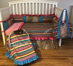 Excited to share this item from my shop: Rodeo Diva Baby Nursery Crib Set 10 pieces made with serape stripes, leopard, and teal floral fabrics handmade with free monograms blanket