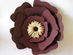 An amazing purple paper flower that can be put on a wall! A beautiful spring or summer paper wedding will be unique with this big paper flower which is a great table top or centerpiece. This handcrafted giant purple flower is a perfect decoration for a birthday, homecoming or any kind of event! A simple wedding will be unique with them! This large paper flower can also be a beautiful floral wall decor. It will be an amazing decoration even for your home or a gift for your friend…