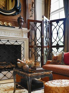 What a yummy space. Love the glass & metal folding screen.. Fireplace screen is fabulous..