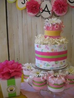 Very cute (baby accessories) cake to go with gerber daisy theme!