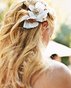 """A lasting version of a """"Sally Holmes"""" rose was created from crepe paper for this bride's hair"""