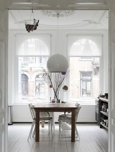 Love this all white Amsterdam apartment I see a lot of similarities between Dutch and Scandinavian style and this beautiful Amsterdam apartment could quite easily be here in Sweden. Dining Room Inspiration, Interior Inspiration, Interior Ideas, Home Living, Living Spaces, City Living, Amsterdam Apartment, Amsterdam Living, White Wooden Floor