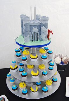 Dawns small castle on top & then tiered prince & princess cupcakes