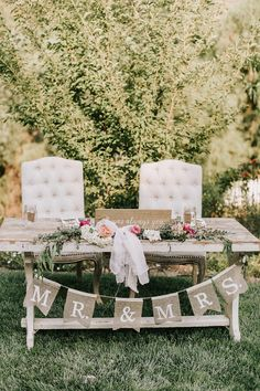 shabby chic sweetheart table with mr and mrs bunting flags