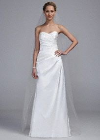 Delicately beautiful and brilliantly designed, this strapless A line gown is truly stunning!  Strapless sweetheart bodice features eye-catching and figure flattering pleated detail.  Lace applique accents add a dazzling touch.  Available online in Soft White and White.  Fully lined. Back zip. Imported polyester. Dry clean. To preserve your wedding dreams, try our Wedding Gown Preservation Kit.