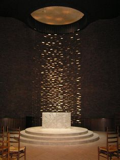 MIT Chapel by Eero Saarinen (1955), with a waterfall metal sculpture by Harry Bertoia that shimmers in the sunlight reflecting and distributing light into the interior of the chapel.
