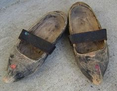 In C14th old English, the word clog meant a lump of wood and the term only gradually came to refer specifically to shoes carved out of a lump of wood. Hard wearing and, more importantly, cheap to make, wooden clogs were the working man's (and woman's) footwear in many communities