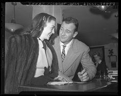 Actor John Wayne and actress Esperanza Baur applying for marriage license in Los Angeles, California, 1946.