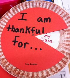 Writing what we are thankful for in a Pumpkin Pie!  Thanksgiving craft.
