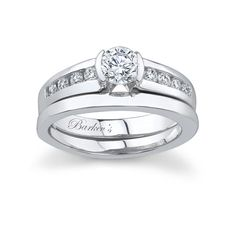 White gold diamond engagement ring set - 4235SW - Barkev's is proud of it's wide selection of bridal sets this bold contemporary diamond engagement ring has a low profile and sports channel set diamonds gracing the center and shoulders of the ring.  A plain bright polished band fits snuggly on either side.    Also available in yellow gold, 18k and Platium.