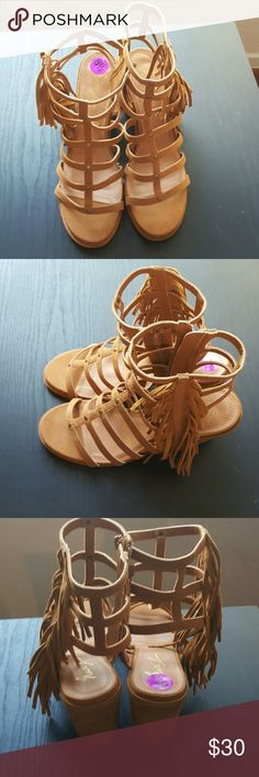 Mari A. Elsa Gladiator Sandal New without Box Heighten any ensemble with these edgy gladiator sandals. Fringe detailing and a caged feel add style and fashion to these must-have heels. 3.5-in. heel Interior zip closure Padded insole Microfiber Suede mari a elsa Shoes Sandals