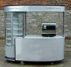 Compact coffee cart kiosk. Like the fridge on the end.