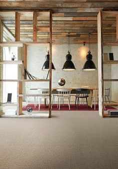 The neutral shade of carpet from the Classic Collection pairs perfectly with the timber ceiling and support beams. This private meeting room / personal office / dining area is closed off, but incorporated into an open floor plan. The red accent rug adds a pop of color to this simple, classic floor design.