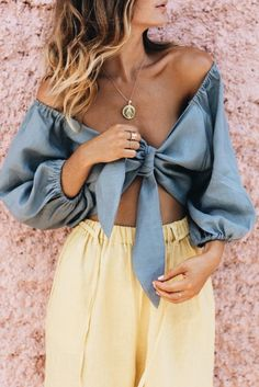 Yellow waistband flowy pants, metallic blue knotted top, gold necklace
