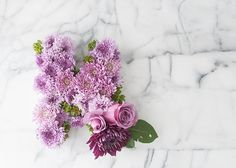 7 Spring Blogger Projects We Love | Midwest Living, paper mâché letter holds flowers in florists foam
