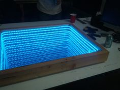 This infinity mirror prototype is small enough to test out the theory before committing to the full project. And the full project that [Kevin] and [Edward] have in mind is a huge infinity portal th… Led Light Projects, Led Projects, Mirror Bed, Mirror Lamp, Infinity Mirror Table, Infinity Spiegel, Infinity Lights, Old Coffee Tables, Led Diy