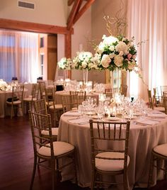An upwash of fabric and spot lighting of flowers highlights design and brings a warm glow to Kirby Horton Hall at Doris Duke Center.  Flowers:Tre Bella Photo:Robin Lin Lighting: Get Lit, Special Event Lighting.