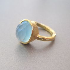 round stone ring. Perfect with any of the pastel colors.