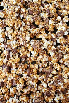 Butter Toffee Heath Popcorn Recipe on twopeasandtheirpod.com We LOVE this sweet popcorn! Beware, it is addicting!