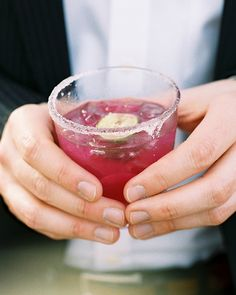 The bride's brother brewed large batches of prickly pear margaritas, using…