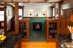 Handsomely detailed with cabinets and tile, the fireplace inglenook lends period style to the addition, as well as storage and seating. A drop-down desk (at left) creates a compact home office. Craftsman Furniture, Craftsman Interior, Craftsman Style Homes, Craftsman Bungalows, Craftsman Houses, Mission Furniture, Gothic Furniture, Craftsman Kitchen, Arts And Crafts House