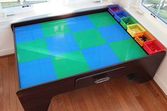Transform a train table into a Lego table with this easy DIY - and organize your bricks too!