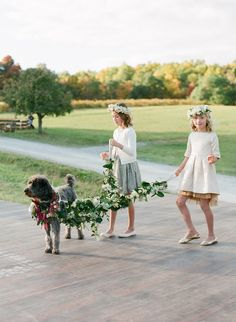 Flower Girls Walking Wedding Dog with Green Garland | Arena's https://www.theknot.com/marketplace/arenas-rochester-ny-311121 | Simply Beautiful Events https://www.theknot.com/marketplace/simply-beautiful-events-rochester-ny-220241 | Lacie Hansen Photography https://www.theknot.com/marketplace/lacie-hansen-photography-santa-barbara-ca-888319