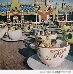 Mad Tea Party - Kids enjoy a ride on the Mad Tea Party at Disneyland in 1955, while Mr. Toad's Wild Ride sits in the background.