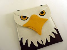 This bald eagle iPad sleeve fits the New iPad (3rd generation), iPad 2 and iPad 1. It is made with 100% wool design felt. The flap is attached with a button.