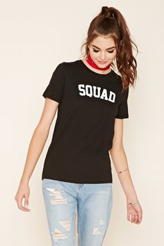 """A knit tee featuring a boxy silhouette, short sleeves, ribbed round neckline, and a """"Squad"""" graphic on the front."""