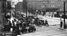 1936 - 1940. Railway crossing at the Linnaeusstraat in Amsterdam. The Linnaeusstraat is located in Amsterdam-Oost between the Mauritskade and the Ringdijk. The street was formerly called Oetewalerweg after the village Oetewaal of Houtewaal, located on a former sea wall near the current Muiderpoort. The oldest mention of the village dates back to 1308. During the construction of the 4th expansion of Amsterdam in 1663 the village was annexed by Amsterdam. #amsterdam #1940