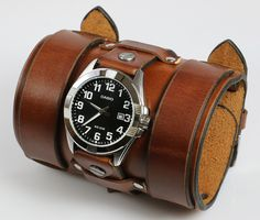 "This is a custom made leather watch cuff. 4"" wide."