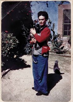 """Frida Kahlo's cat feeling shunned as she snuggles a monkey -via flavorwire, """"Famous Artists Photographed with Their Cats"""""""