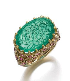 Emerald and ruby ring, Cartier, Photo courtesy Sotheby's. Centring on a carved oval cabochon emerald, inset to a foliate open. Emerald Jewelry, Gems Jewelry, Fine Jewelry, Diamond Jewelry, Cartier, Antique Jewelry, Vintage Jewelry, Bracelets, Jewelry Design