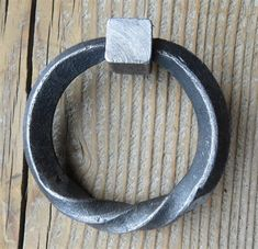 Raw, unfinished metal ring with twisted base. Comes in multiple sizes. Blacksmith Supplies, Craft Iron, Twist Ring, Furniture Hardware, Door Knockers, Blacksmithing, Metal Ring, Base, Rings