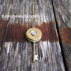 Bullet necklace on a lock and key bezel and gold chain.