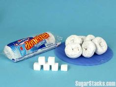 Donettes, Powdered Sugar 6 Donuts (85g) Sugars, total: 23g Calories, total: 340 Calories from sugar: 92  The World Health Organization is dropping its sugar intake recommendations from 10 percent of your daily calorie intake to 5 percent. For an adult of a normal body mass index (BMI), that works out to about 6 teaspoons -- or 25 grams -- of sugar per day.