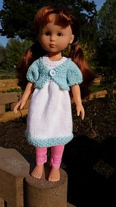 A fresh spring dress, complete with a puff sleeve cardigan for the lingering chill in the air. Dress is constructed from the bottom up in the round to the bodice, and then front and back are knit separately. Jacket is constructed seamlessly in one piece using raglan seams. Pattern is sized for Les Cheries or Hearts for Hearts dolls, or other dolls of similar size.