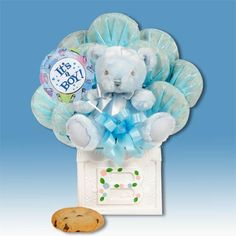 """A New Baby Boy Cookie Bouquet or  A New Baby Girl Cookie Bouquet     This 5x5 decorated melamine baby block is brimming with twelve delicious cookies, 6"""" plush bear rattle and mylar balloon. Perfect for storing baby items when the cookies are gone. Selection includes:chocolate chip, oatmeal raisin, sugar, peanut butter, M, white chocolate chip pecan  $44.99  http://www.littlegiftbasketboutique.com/item_34/A-New-Baby-Boy-Cookie-Bouquet.htm"""