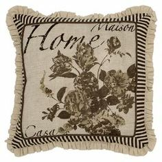 "Jute and cotton pillow with a floral motif and ruffled trim.   Product: PillowConstruction Material: Jute and cottonColor: MultiFeatures:  Printed vintage pattern with ruffled trimWooden button closure Insert includedDimensions: 18"" x 18"" Cleaning and Care: Hand wash in cold water with mild detergent"